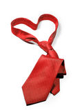 Love always red necktie gift. Red tie with a heart shape knot isolated on a white background Royalty Free Stock Image