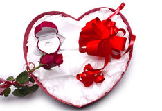 Love.Red roses, an engagement ring and heart. Stock Photography