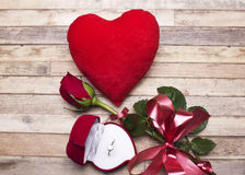 Love.Red roses, an engagement ring and heart. Royalty Free Stock Photo