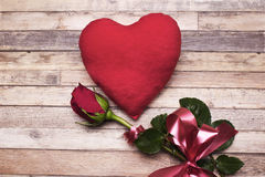 Love.Red roses, an engagement ring and heart. Stock Images
