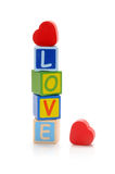 Love. Red wooden hearts with love wooden letters Royalty Free Stock Photo