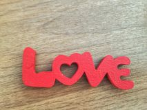 Love. Red word from cutting wood and paint placed on wood table Stock Photos