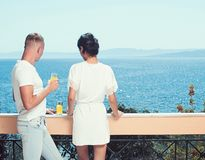 Love relations of couple enjoying fresh juice. Morning time of woman and man at sea resort. Couple in love relax on. Love relations of couple enjoying fresh royalty free stock image