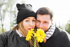 Love, relationship, family and people concept - couple with bouquet of gerberas in autumn park Stock Image
