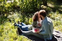 Love, relationship, family and people concept - smiling couple hugging in autumn park stock photography