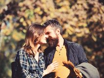 Love, relationship, family and people concept - smiling couple hugging. In autumn park and kissing. Autumn date and relationship stock photography