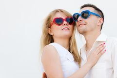 Man and woman wearing heart shape sunglasses Stock Images
