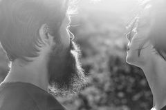 Love relationship. Sensual couple in sunlight. Love relationship. Sensual couple of women beautiful brunette short hair and men handsome bearded in sunlight on royalty free stock image
