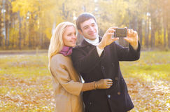 Love, relationship, technology and people concept - happy couple royalty free stock photos