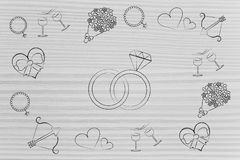 Wedding rings surrounded by romance and love-themed symbols Stock Photography
