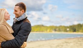 Happy couple hugging over autumn beach royalty free stock photos