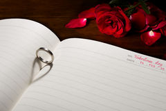Love ring. The shadow of ring is heart on a book stock photo