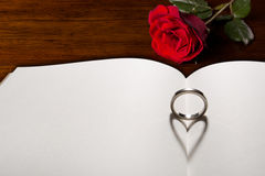 Love ring. The shadow of ring is heart on a book stock photography