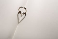 Love ring. The shadow of ring is heart on a book stock images