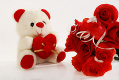 Love & romance. This is a beautiful teddy bear with red roses. its a symbol of love and romance Stock Images