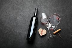 Love and romance, a bottle of red wine and a heart stock images