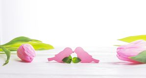 Love and romance. Happy Valentine`s Day. Two birds and pink tulips on a light background. Free space. Love and romance. Happy Valentine`s Day. Two pink birds and stock photos