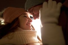 Close up of happy couple in winter clothes Stock Photo