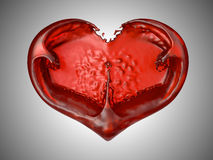 Love and Romance - Red liquid heart shape. Over grey background Stock Photo