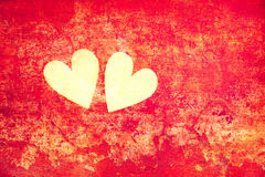 Love and romance. Symbols of love - hearts on the abstract red background royalty free stock photography
