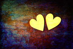 Love and romance. Two hearts on abstract multicolored background with wooden texture Stock Photo