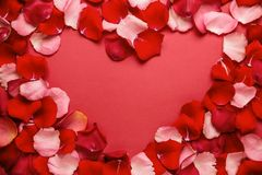 Love romantic background. heart Frame of rose petals on a red background.  royalty free stock images