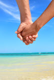 Love - romantic couple holding hands on beach Royalty Free Stock Photo