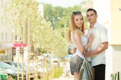 Happy couple walking in city enjoying romance Stock Photo