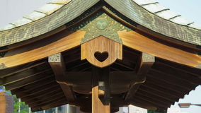 Love on the roof. In Japan, the shrine roof have a loving symbol stock photo