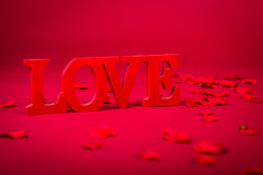 Love and Roses. Picture of the word love on a red background stock photography