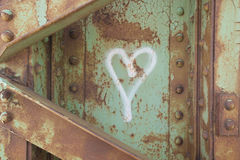 Love in Ruins. Hear shape hand painted on a rusted steel beam Royalty Free Stock Photo
