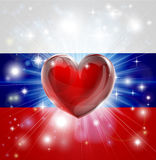 Love Russia flag heart background. Flag of Russia patriotic background with pyrotechnic or light burst and love heart in the centre Stock Images