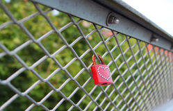 love: rusty red padlock on a bridge Royalty Free Stock Photography
