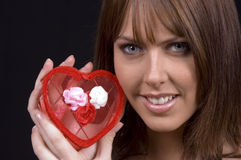 Love's Smile. Love's Beauty! Brunette holding a heart box top Stock Images