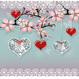 Love sakura tree with hanging red and lace hearts Royalty Free Stock Photography