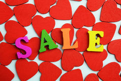 Love sale. A lot of hearts on the floor and the word selling Royalty Free Stock Photo