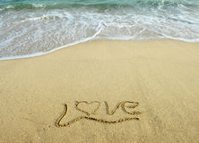 Love in the sand Stock Photos