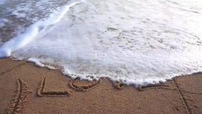 LOVE on sand beach stock footage