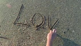 Love on sand stock footage
