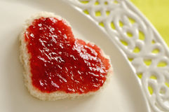 Love Sandwich. Romantic breakfast with a heart shaped sandwich Royalty Free Stock Images