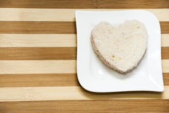 Love sandwich on a wooden background Royalty Free Stock Photos