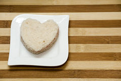 Love sandwich on a wooden background Royalty Free Stock Photography