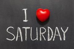 Love Saturday. I love Saturday phrase handwritten on the school blackboard stock image
