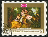 Love Scale by Watteau. YEMEN - CIRCA 1972: stamp printed by Yemen, shows The Love Scale by Watteau, circa 1972 Royalty Free Stock Image
