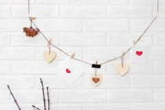 LOve scandinavian loft brown natural wooden valentines garland w Stock Photos