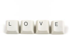 Love from scattered keyboard keys on white. Love text from scattered keyboard keys isolated on white background royalty free stock photo