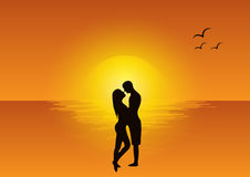 Love scene at sunset Stock Image