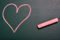 Love in school. Love my teacher written on green chalkboard in school Royalty Free Stock Photo