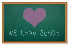 WE LOVE SCHOOL. Heart shape on grunge green chalkboard and worlding WE LOVE SCHOOL Stock Photo