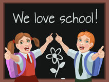 We love the school!. The children go to school with a new joyful mood and a meeting with classmates and friends and favorite teacher, they love to learn Stock Photo